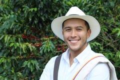 Knappe landbouwer in koffieaanplanting royalty-vrije stock foto