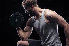 Knappe machts atletische mens met domoor Royalty-vrije Stock Afbeelding