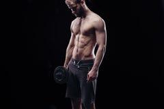 Knappe machts atletische mens met domoor Stock Foto's