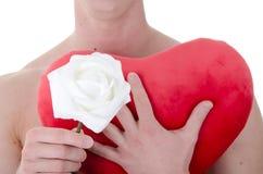 Knappe mens en bloemen royalty-vrije stock foto's