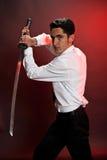 Knappe mens met zwaard. Royalty-vrije Stock Foto's