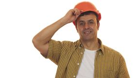 Knappe rijpe ingenieur die bouwvakker dragen die vol vertrouwen glimlachen royalty-vrije stock afbeelding