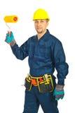 Knappe werkman met verfrol Stock Foto's