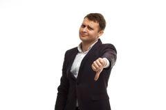 Knappe zakenman die duim neer tonen Royalty-vrije Stock Foto's