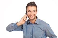 Knappe zakenman die met een telefoon glimlacht Royalty-vrije Stock Fotografie