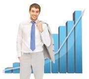 Knappe zakenman met grote 3d grafiek Stock Foto