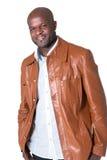 Knappe zwarte mens met geïsoleerded leerjasje Royalty-vrije Stock Foto's
