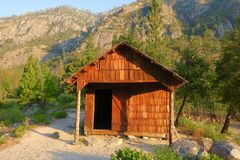 Knapps cabin. Historical cabin with shingled walls and roof with mountain in background. Off the beaten track in Kings Canyon National Park, California, United Stock Photography