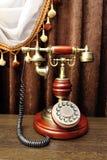 Knapptelefon i antik stil royaltyfri bild