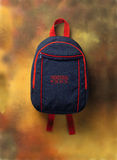 Knapsack. A blue knapsack over a brown background Stock Photos