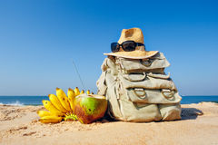 Knapsack on the beach. Knapsack, hat and fruit on the sandy beach Stock Images