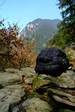 Knapsack. A knapsack in the mountain road Stock Image