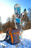 Knapsack near the snowboard. Knapsack on the snow near the snowboard Stock Image