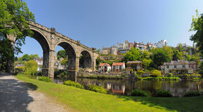 Knaresborough viaduct panorama, England. Wide panoramic view of old viaduct bridge in Knaresborough, taken in bright summer sunlight from the bank of river Nidd Royalty Free Stock Photos