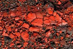 Knastrat rött färgpulver Arkivbild