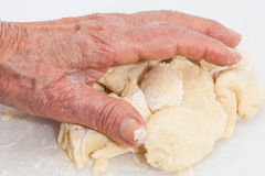 Knead cookies dough by hand Royalty Free Stock Photo