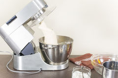 Knead the dough on a food processor Stock Image