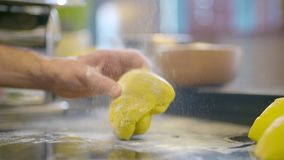 Knead dough in hands close up. Knead gough in hands before baking bread stock video footage