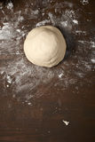 Knead dough on wooden table Stock Photography
