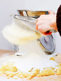 Knead home. Knead at home on wooden chopping board Stock Photography