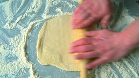 Knead and roll dough for pizza stock video