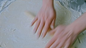 Knead and roll dough for pizza stock footage