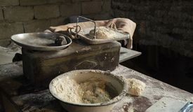 Knead and weigh dough royalty free stock images
