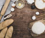 Kneaded dough and ingredients for making bread royalty free stock image