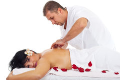 Kneaded massage on woman back at spa Stock Photos
