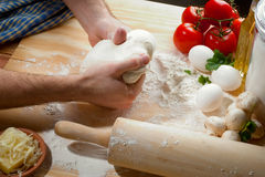 Kneading a dough Stock Images