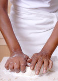 Kneading dough. Baker preparing either pizza or bread dough in the kitchen royalty free stock photos