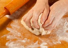 Kneading the dough Stock Images