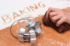 Kneading dough for Christmas cookies and accessories Royalty Free Stock Photography