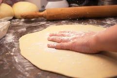 Kneading dough. Close Up of female hand kneading dough Stock Photos