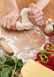 Kneading Dough for Pizza Royalty Free Stock Images