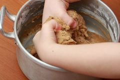 Kneading the dough in the pot. Two hands kneading the dough in the pot Stock Photography