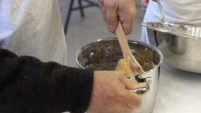 Kneading dough in a saucepan stock footage