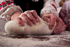 Kneading dough on table Royalty Free Stock Image