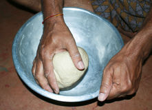 Kneading flour dough manually. Flour dough being kneaded manually for Indian bread called Roti royalty free stock images