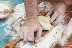 Kneading pizza dough Royalty Free Stock Images