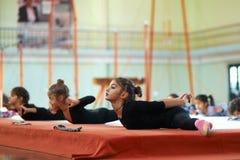 She kneads  back in training rhythmic gymnastics Stock Photo