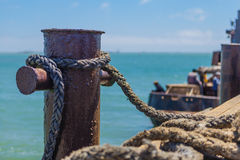 Knecht tied with rope. On the dock stock image
