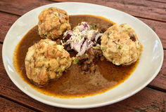Knedlik dumplings in the meat sauce Stock Images