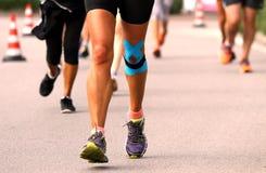 Knee bandaged by medical bandage runner Stock Image