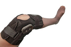 Knee brace. Female leg in knee brace used after knee injury isolated on white Stock Photos