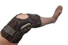 Knee brace. Female leg in knee brace used after knee injury isolated on white stock photos