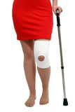 Knee Brace with Cane Royalty Free Stock Image