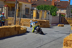 Almost Knee Down On A Motorcycle. A racer takes a bend during the Algueña motorcycle race in Spain stock photography