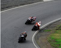 Knee Dragger. Three motorcycles in a tight race cornering Royalty Free Stock Photography