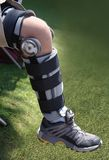 Knee injury. A shot of a knee brace on leg Stock Photos